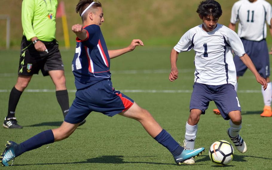 Aviano's Cole Heathcliff stretches to tip the ball away from Spangdahlem's Luis Martinez in the teams' 0-0 tie in Division II action at the the DODEA-Europe soccer finals in Landstuhl, Germany, Monday, May 21, 2018.