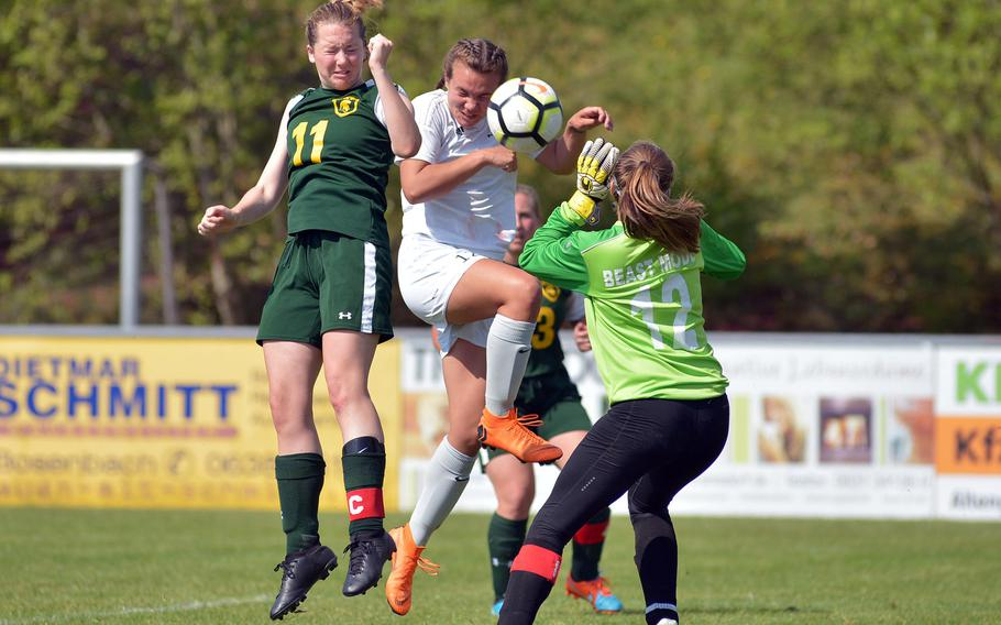 Ramstein's Aurora Davis heads a shot against SHAPE's Abigail Ganzemuller, left, and Katherine Kacher in the Royals 3-0 win over the Spartans at the DODEA-Europe soccer championships in Reichenbach, Germany, Tuesday, May 22, 2018.