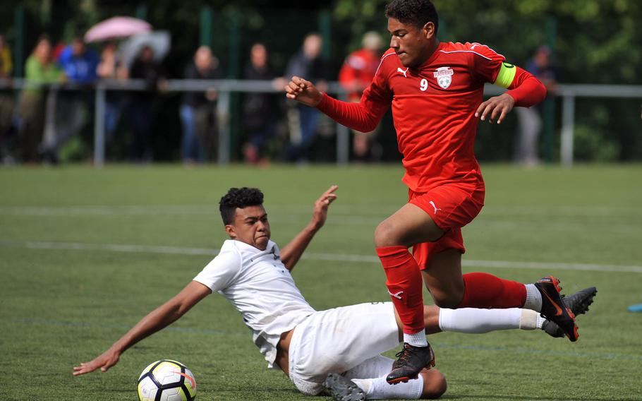 Kaiserslautern's Pablo Zorrilla gets past Ramstein's Noah Yancy at the DODEA-Europe soccer championships in Reichenbach, Germany, Tuesday, May 22, 2018. The teams played to a 1-1 tie and both advanced to Wednesday's semifinals.