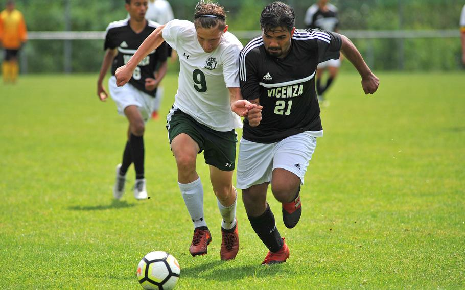 SHAPE's Marek Mikulenka, left, and Vicenza's Mason Suarez fight for the ball at the DODEA-Europe soccer championships in Reichenbach, Germany, Tuesday, May 22, 2018. SHAPE beat the cougars 4-0.