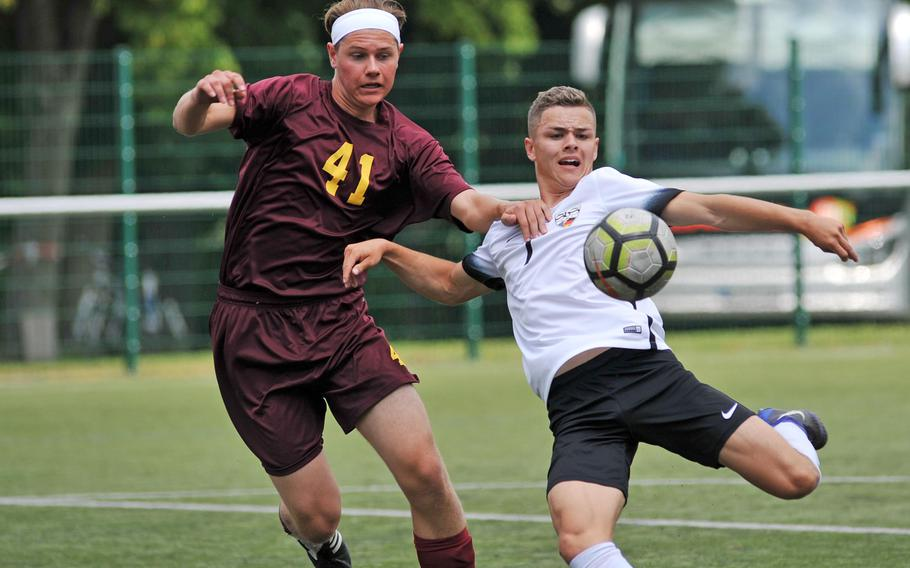 Stuttgart's Abe Engelke scores despite the defense of Vilseck's Matthew Bergosh at the DODEA-Europe soccer championships in Reichenbach, Germany, Tuesday, May 22, 2018. The Panthers won 7-0.