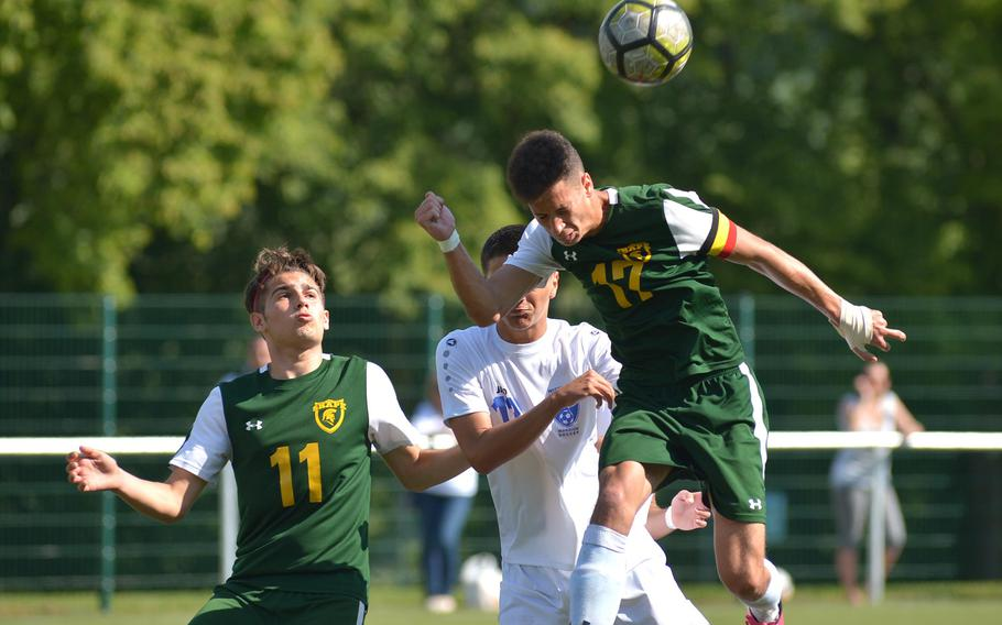 SHAPE's Joshua Merck-Rocha clears with a header in front of Wiesbaden's Alexander Arcila as teammate Cesare Vetrano watches. Wiesbaden beat SHAPE 2-0 at the DODEA-Europe soccer championships in Reichenbach, Germany, Tuesday, May 22, 2018.