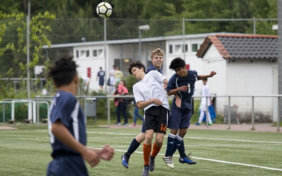 Spangdahlem's Luis Martinez, right, heads the ball away from AFNORTH's James Barata during the DODEA-Europe soccer championships in Landstuhl, Germany, on Tuesday, May 22, 2018. AFNORTH won the Division II match 2-1 and advances to the semifinals.