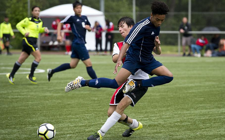Black Forest Academy's Branch Walton, right, leaps over a block by American Overseas School of Rome's Christian Sjoman during the DODEA-Europe soccer championships in Landstuhl, Germany, on Tuesday, May 22, 2018. AOSR won the Division II match 2-1.