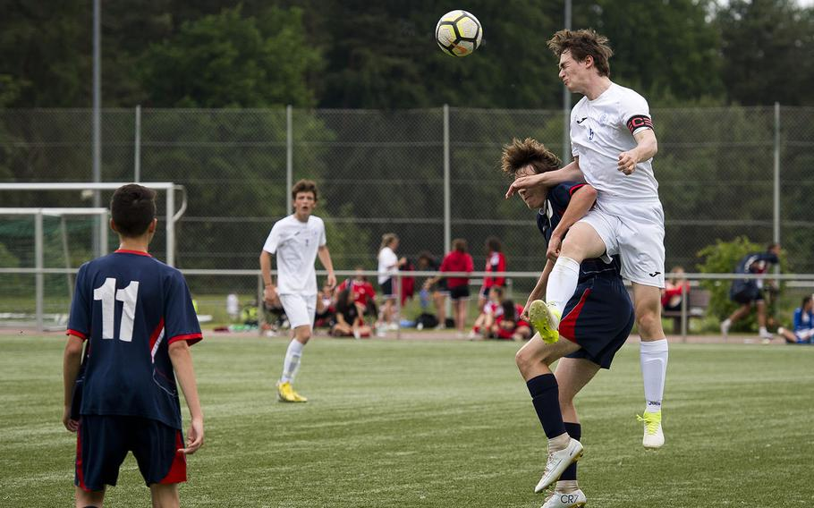 Marymount's Alexander Klarenbeek, right, heads the ball over Aviano's Luke Farrington during the DODEA-Europe soccer championships in Landstuhl, Germany, on Tuesday, May 22, 2018. The Division II match ended in a 1-1 tie with Marymount advancing to the semifinals.