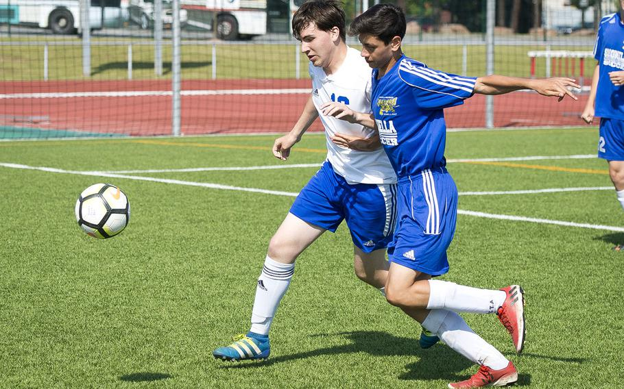 Sigonella's Noah Bachicha, right, and Hohenfels' Shane Colbert race for the ball during the DODEA-Europe soccer championships in Kaiserslautern, Germany, on Tuesday, May 22, 2018. Sigonella won the Division III match 7-0.
