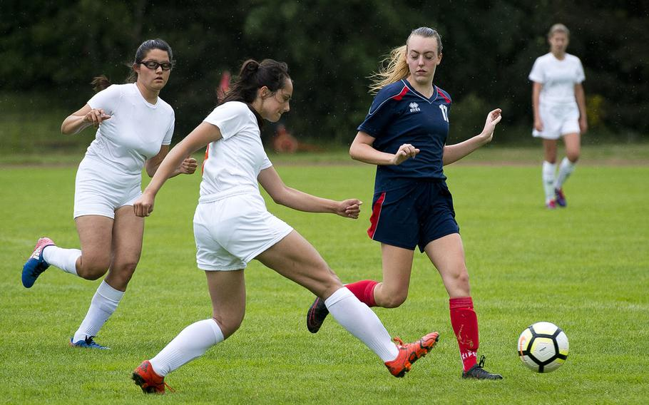 Spangdahlem's Emelia Lenz passes the ball in front of Aviano's Nilla Hall, right, as fellow Sentinel Summer Flores runs to assist during the DODEA-Europe soccer championships in Landstuhl, Germany, on Tuesday, May 22, 2018. Spangdhalem won the Division II match 7-0 and advances to the semifinals.