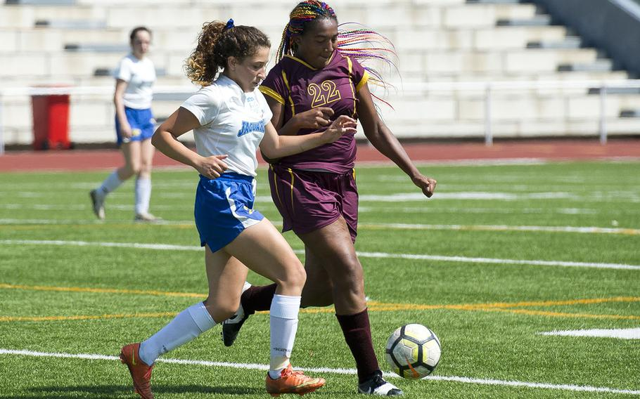 Sigonella's Aeriell Colodro, left, and Baumholder's Sierra Green race for the ball during the DODEA-Europe soccer championships in Kaiserslautern, Germany, on Tuesday, May 22, 2018. Sigonella won the Division III match 1-0.