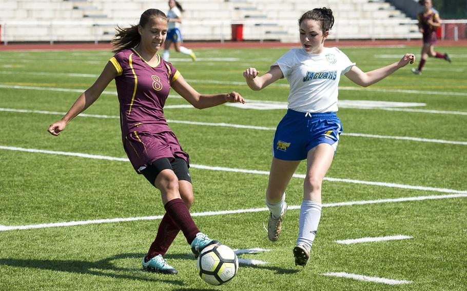 Baumholder's Lydia Coyour, left, tries to clear the ball ahead of Sigonella's Cecelia Warren during the DODEA-Europe soccer championships in Kaiserslautern, Germany, on Tuesday, May 22, 2018.