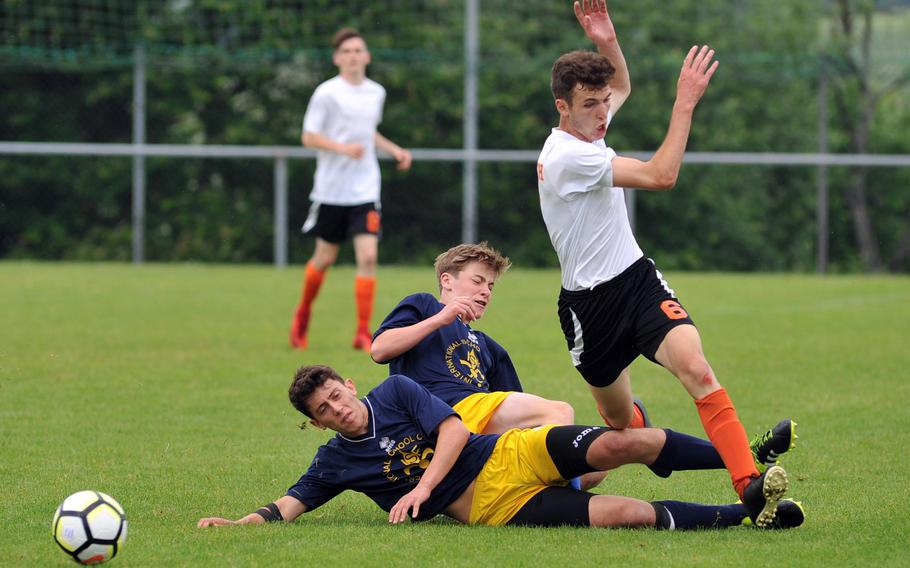 Florence's Manfredi Galli, left, and Matteo Roncaglia team up to stop AFNORTH's Guillermo Rodriguez in a Division II semifinal at the DODEA-Europe soccer finals in Reichenbach, Germany, Wednesday, May 23, 2018. AFNORTH won 3-2 to advance to Thursday's final.