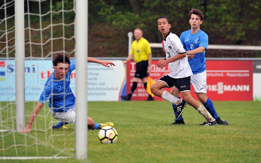 AOSR's Guglielmo Fradusco looks his shot toward the net for a goal as Marymount's Antonio Di Tommaso, left, and Lorenzo Estero watch. Despite Fradusco's efforts, Marymount won the Division II semifinal at the DODEA-Europe soccer finals in Reichenbach, Germany, 4-2 to advance to Thursday's final.