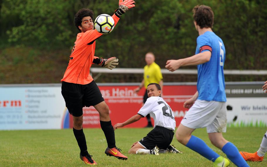 Marymount keeper Akrm El Weikel get a hand on a shot by AOSR's Gugliemo Fradusco, center, as teammate Alexander Klarenbeek watches. Marymount won the Division II semifinal at the DODEA-Europe soccer finals in Reichenbach, Germany, 4-2 to advance to Thursday's final.
