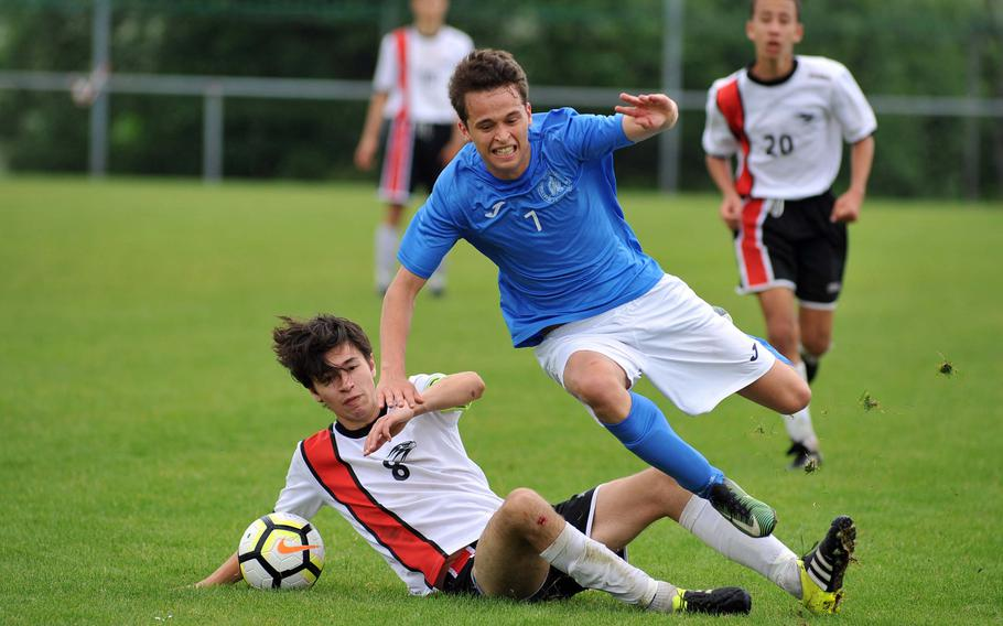 AOSR's Christian Sjoman fouls Marymount's Julian Van Hensbergen in a Division II semifinal at the DODEA-Europe soccer finals in Reichenbach, Germany, Wednesday, May 23, 2018. Sjoman was sent from the field for the foul, and Marymount won 4-2 to advance to Thursday's final.