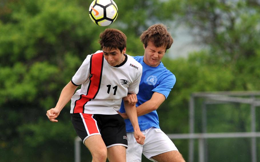 AOSR's Tommaso Articoli heads the ball away from Marymount's Mario Freilino in a Division II semifinal at the DODEA-Europe soccer finals in Reichenbach, Germany, Wednesday, May 23, 2018. Marymount won 4-2 to advance to Thursday's final.