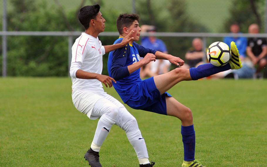 Wiesbaden's Diego Chavez uses some fancy footwork to get past Kaiserslautern's Johann Mendez in a Division I semifinal at the DODEA-Europe soccer finals in Reichenbach, Germany, Wednesday, May 23, 2018. Kaiserslautern beat the Warriors 4-1 to advance to Thursday's division final.