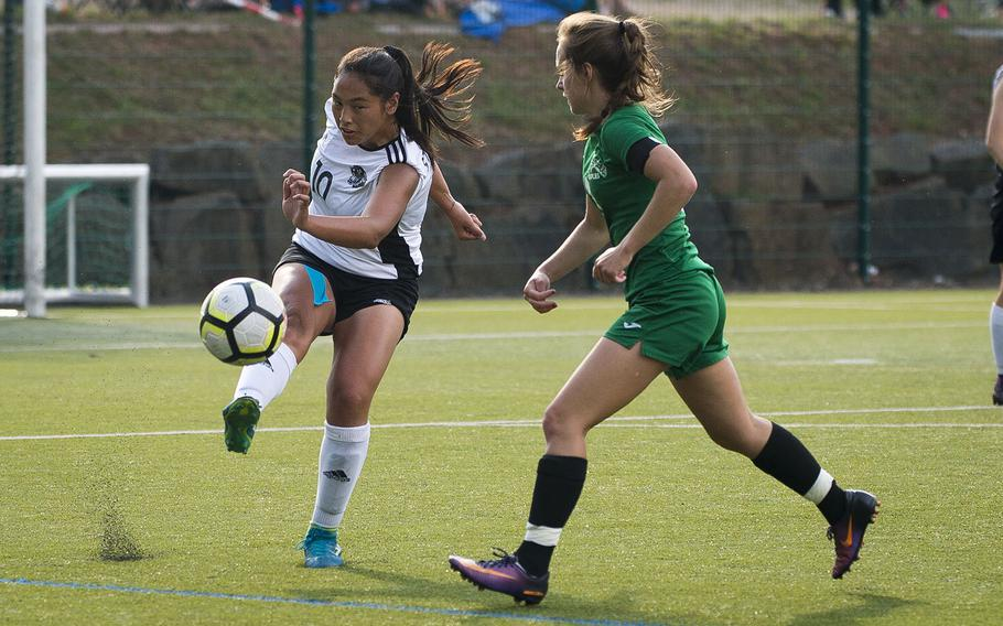 Stuttgart's Camille Pereira, left, clears the ball past Naples' Cora Houseworth during the DODEA-Europe soccer championships in Reichenbach, Germany, on Wednesday, May 23, 2018.