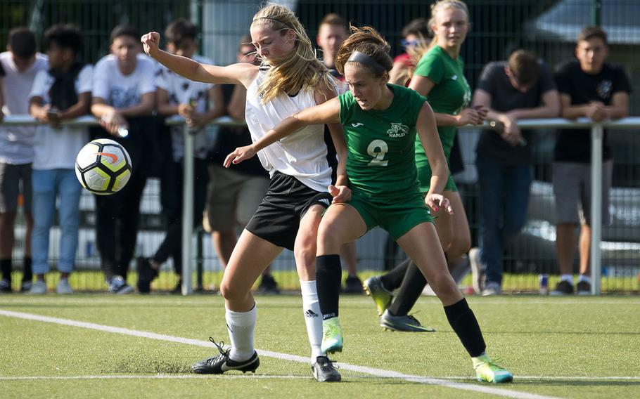 Naples' Abigail Houseworth, right, and Stuttgart's Erin Taylor battle for the ball during the DODEA-Europe soccer championships in Reichenbach, Germany, on Wednesday, May 23, 2018.
