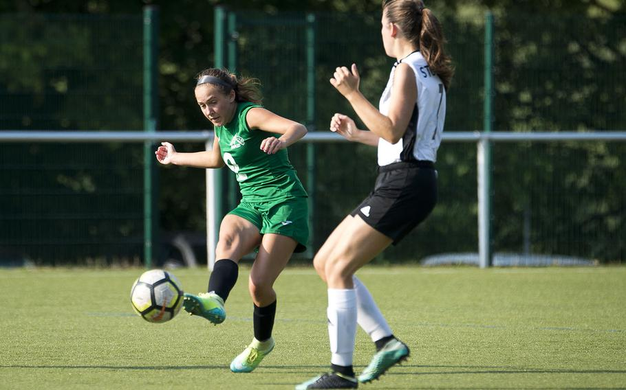 Naples' Abigail Houseworth, left, passes the ball around Stuttgart's Trinity Leahy during the DODEA-Europe soccer championships in Reichenbach, Germany, on Wednesday, May 23, 2018. Naples lost the Division I semifinal match 3-1.