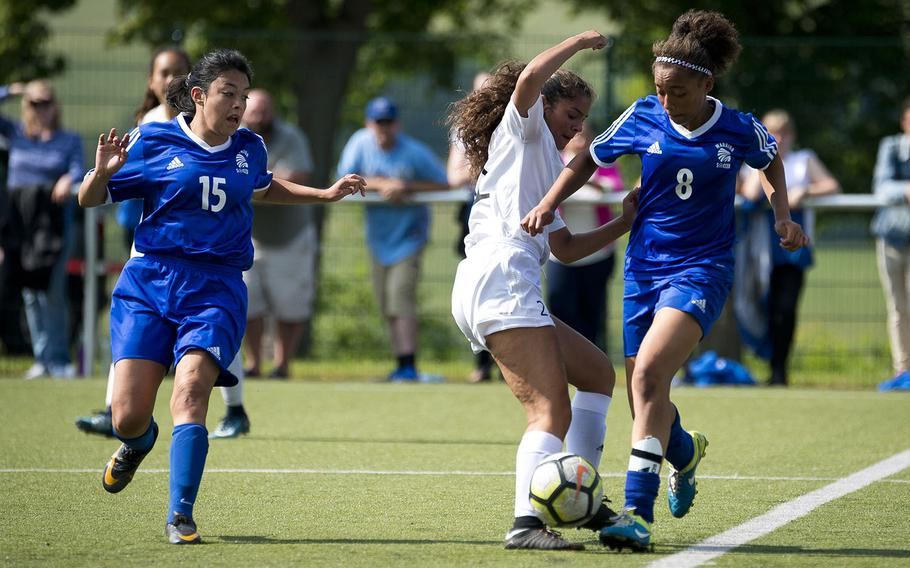 Wiesbaden's Jade Anderson, right, steals the ball from Ramstein's Jaelynn Galindo as fellow Warrior Brianna Greenfield runs to assist during the DODEA-Europe soccer championships in Reichenbach, Germany, on Wednesday, May 23, 2018.