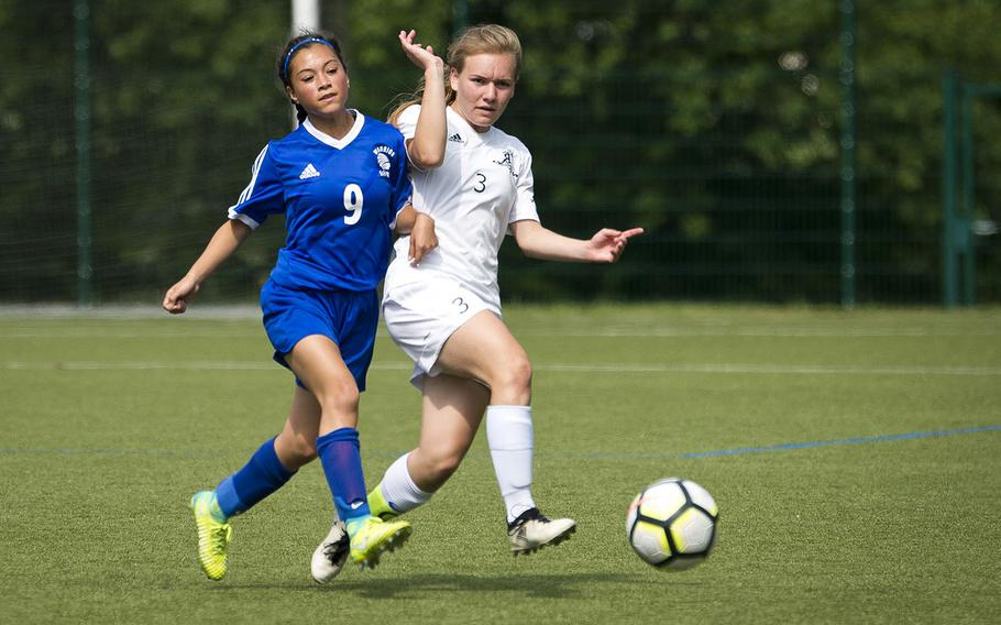 Wiesbaden's Mia Rangel, left, and Ramstein's Leisel Mendenhall battle for the ball during the DODEA-Europe soccer championships in Reichenbach, Germany, on Wednesday, May 23, 2018. Wiesbaden lost the Division I semifinal match 3-1.