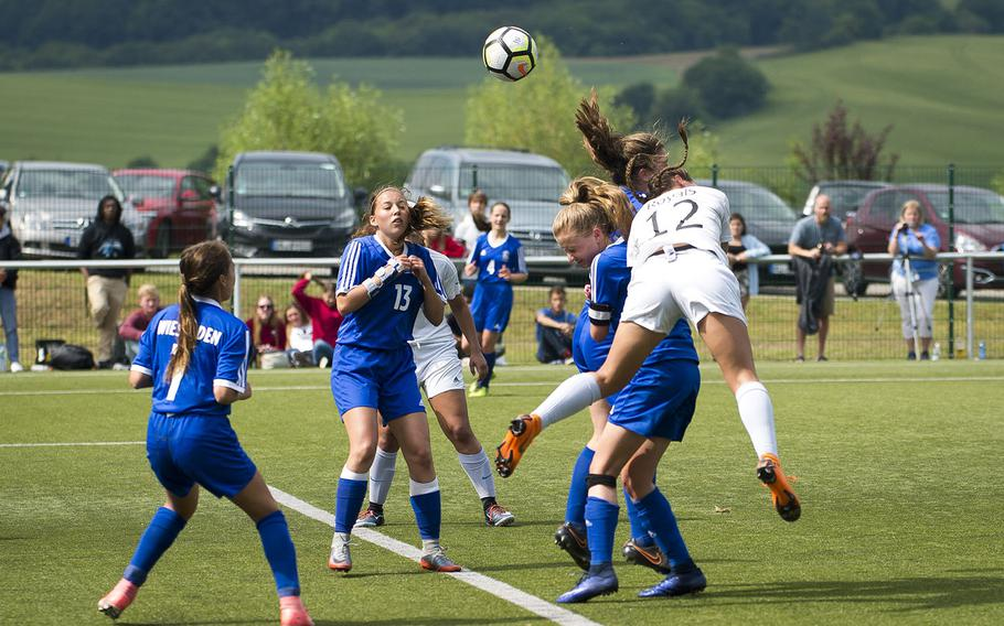 Ramstein's Aurora Davis, right, heads a corner kick during the DODEA-Europe soccer championships in Reichenbach, Germany, on Wednesday, May 23, 2018.