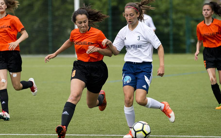 Black Forest Academy's Rebecca Losey, right, beats Spangdhalem's Emelia Lenz to the ball during the DODEA-Europe soccer championships in Reichenbach, Germany, on Wednesday, May 23, 2018. BFA lost the Division II semifinal match 1-0.
