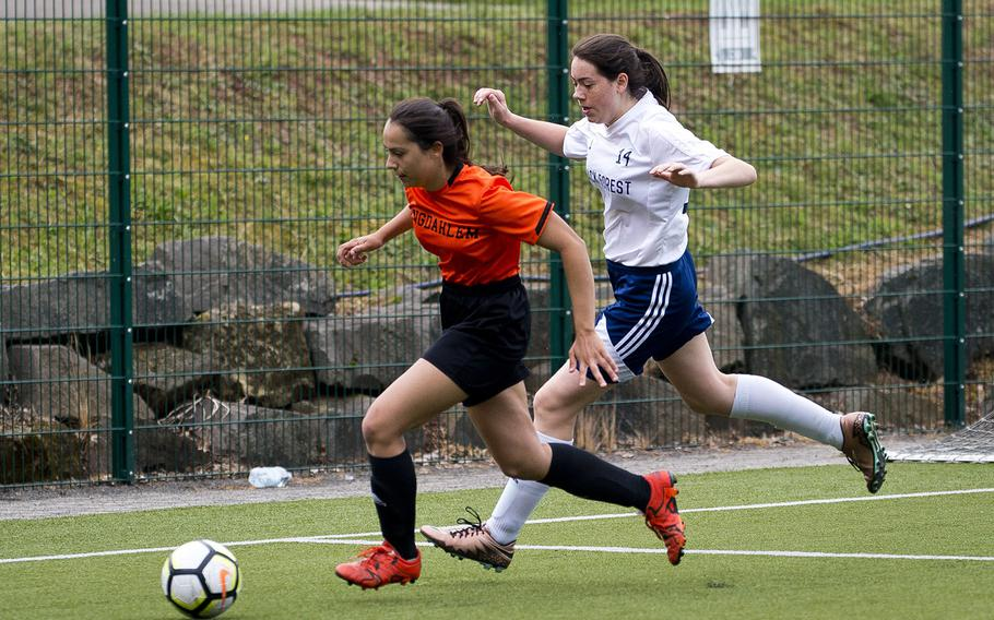 Spangdhalem's Emelia Lenz, left, and Black Forest Academy's Kennedy Wilbanks race for the ball during the DODEA-Europe soccer championships in Reichenbach, Germany, on Wednesday, May 23, 2018. Spangdhalem won the Division II semifinal match 1-0.