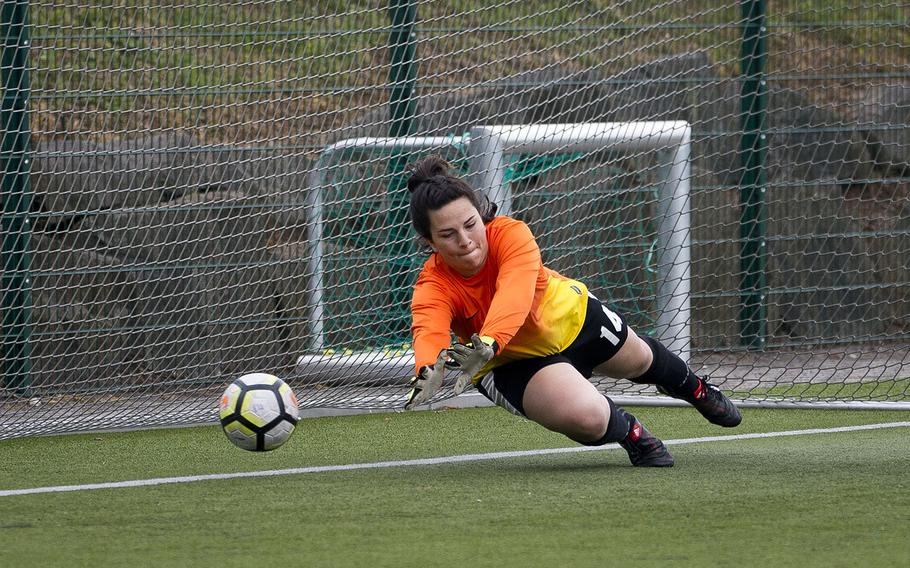 AFNORTH's Rachel Lee dives for a penalty kick during the DODEA-Europe soccer championships in Reichenbach, Germany, on Wednesday, May 23, 2018. AFNORTH lost the Division II semifinal match against Rota 3-1.
