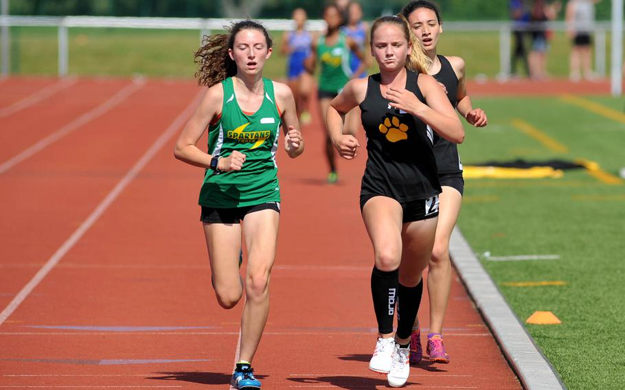 Stuttgart's McKinley Fielding, center, leads SHAPE's Holly Moser and teammate Tatiana Smith around the track midway through the girls 3,200-meter race at the DODEA-Europe track and field championships in Kaiserslautern, Germany, Friday, May 25, 2018. Fielding won the race in 11 minutes 48.80 seconds.