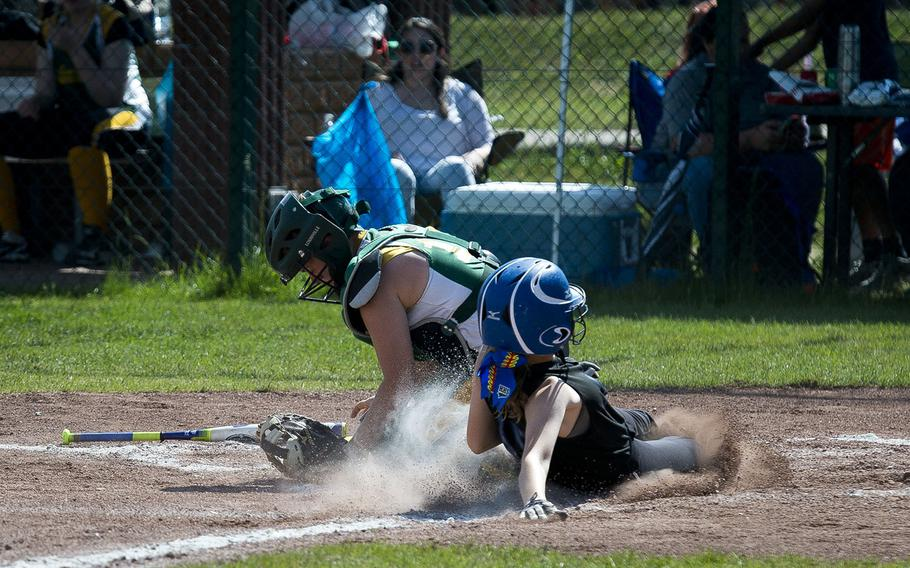 Hohenfels' Aubrey Bruhn, right, slides in safe at home ahead of a tag by Alconbury's Vivian Newcomer during the DODEA-Europe softball tournament at Ramstein Air Base, Germany, on Friday, May 25, 2018. Hohenfels won the Division II/III game against Alconbury 16-3.