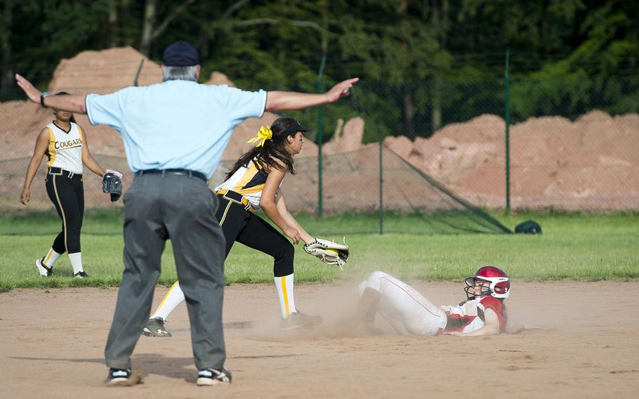 Kaiserslautern's Chloe Whisennand, right, slides into second ahead of a tag by Vicenza's Giulia Sanchez during the DODEA-Europe softball tournament in Kaiserslautern, Germany, on Friday, May 25, 2018.