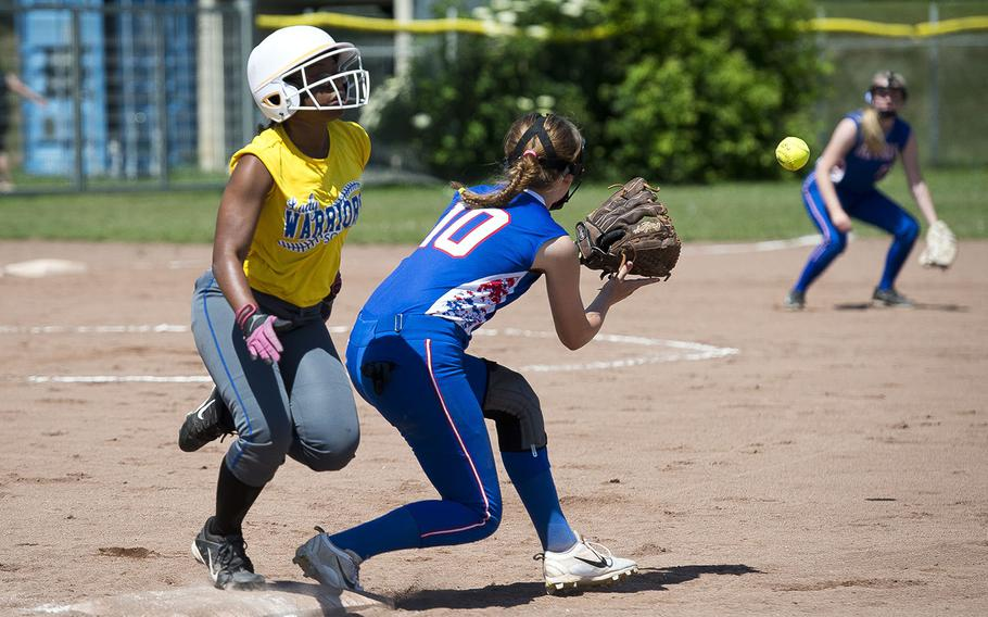 Wiesbaden's TiYonna Dillard, left, is safe at first ahead of a throw to Ramstein's Mikaela McBroom during the DODEA-Europe softball tournament in Kaiserslautern, Germany, on Friday, May 25, 2018.