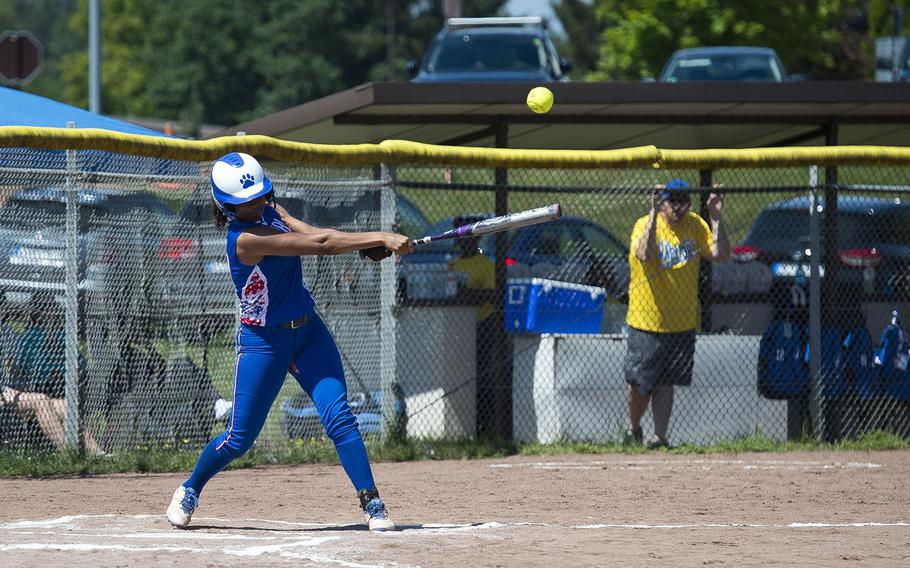 Ramstein's Savannah Sparrow hits the ball during the DODEA-Europe softball tournament in Kaiserslautern, Germany, on Friday, May 25, 2018. Ramstein won the Division I game against Wiesbaden 7-4 and advances to the semifinals.