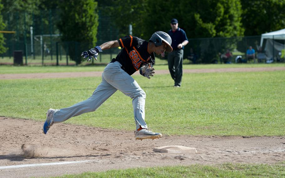 Spangdhalem's Jimmie Montgomery rounds third during the DODEA-Europe baseball tournament at Ramstein Air Base, Germany, on Friday, May 25, 2018.