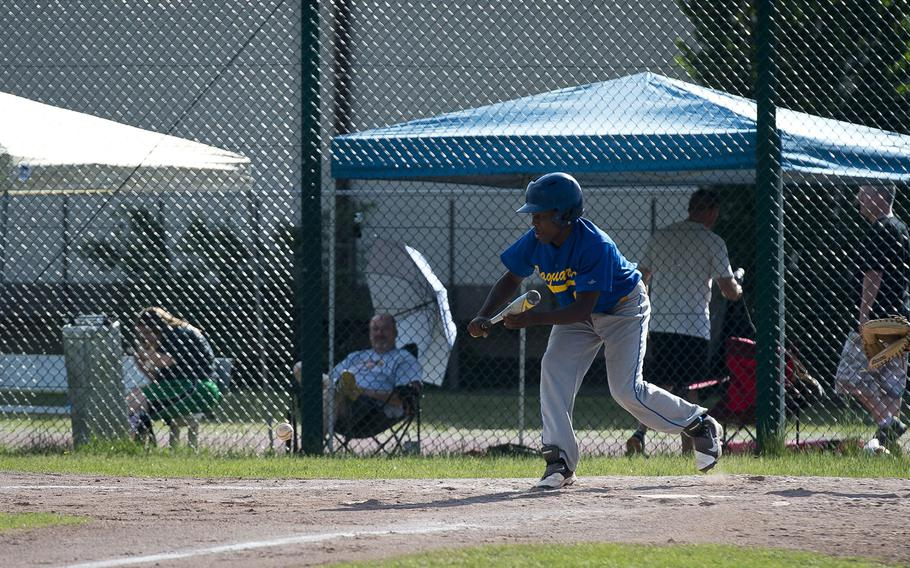 Sigonella's Keshawn Campbell bunts the ball during the DODEA-Europe baseball tournament at Ramstein Air Base, Germany, on Friday, May 25, 2018.