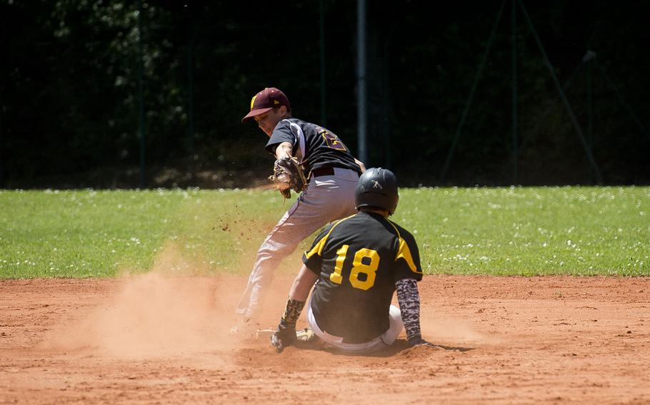 Stuttgart's Peyton Douglas, right, slides in safe at second ahead of a throw to Vilseck's Rian Ritter during the DODEA-Europe baseball tournament in Kaiserslautern, Germany, on Friday, May 25, 2018.