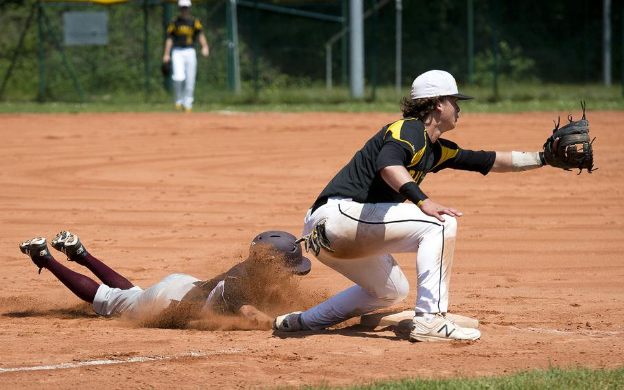 Vilseck's Johnathon Alvarado, left, slides in safe at third ahead of a throw to Stuttgart's Lisle Babock during the DODEA-Europe baseball tournament in Kaiserslautern, Germany, on Friday, May 25, 2018.