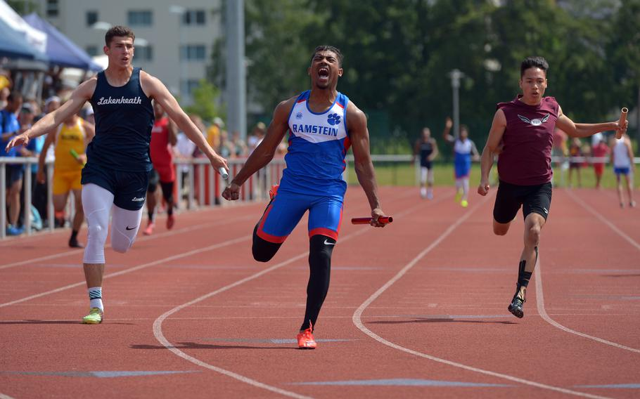 Ramstein's Dominique Arizpe reacts after anchoring the boys 4x100-meter relay at the DODEA-Europe track and field championships in Kaiserslautern, Germany, Saturday May 26, 2018. Arzipe and  teammates Jackie Harris, Nick Lowe and Gevaughn Bracy won in 43.72 seconds ahead of  Lakenheath and Vilseck.
