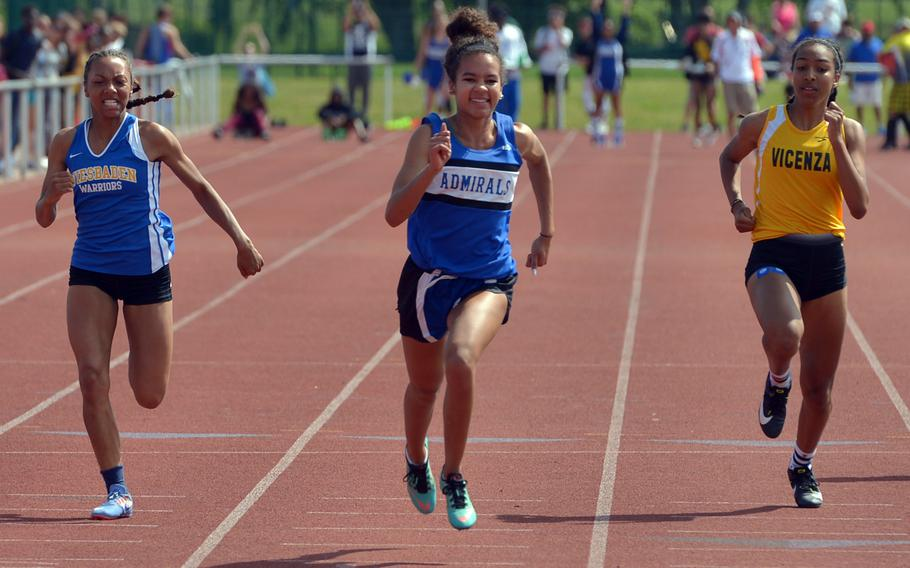 Rota's Deja Alexis was all smiles most of the way down the track on her way to winning the 100-meter dash at the DODEA-Europe track and field finals in 12.13 seconds, ahead of Wiesbaden's Whitney Bivins, left, and Vicenza's Brandy James.