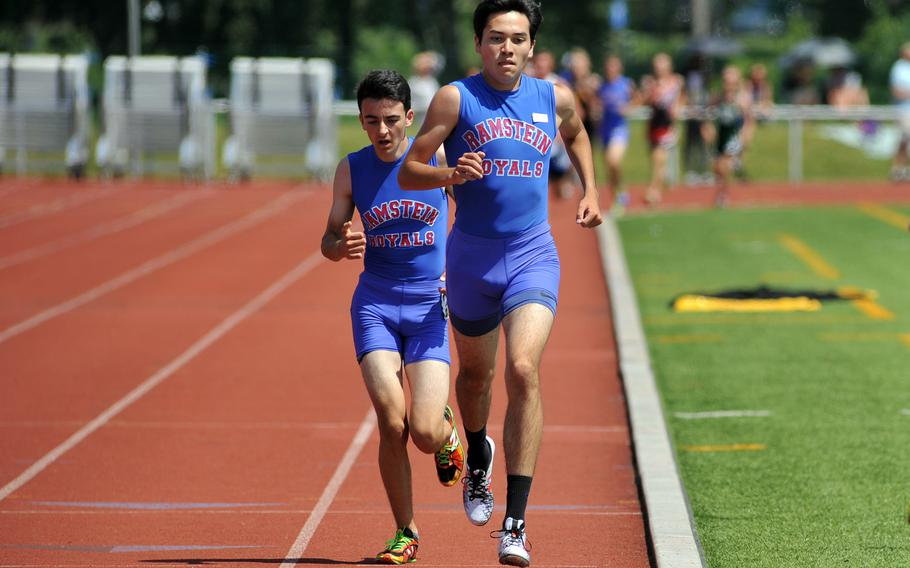 Jose Serrano leads teammate Dashiell Rogers in the boys 3,200-meter run at the DODEA-Europe track and field championships. In a race with numerous lead changes between the two, Serrano came out in front, winning in 9 minutes, 51.43 seconds, a new DODEA-Europe record.