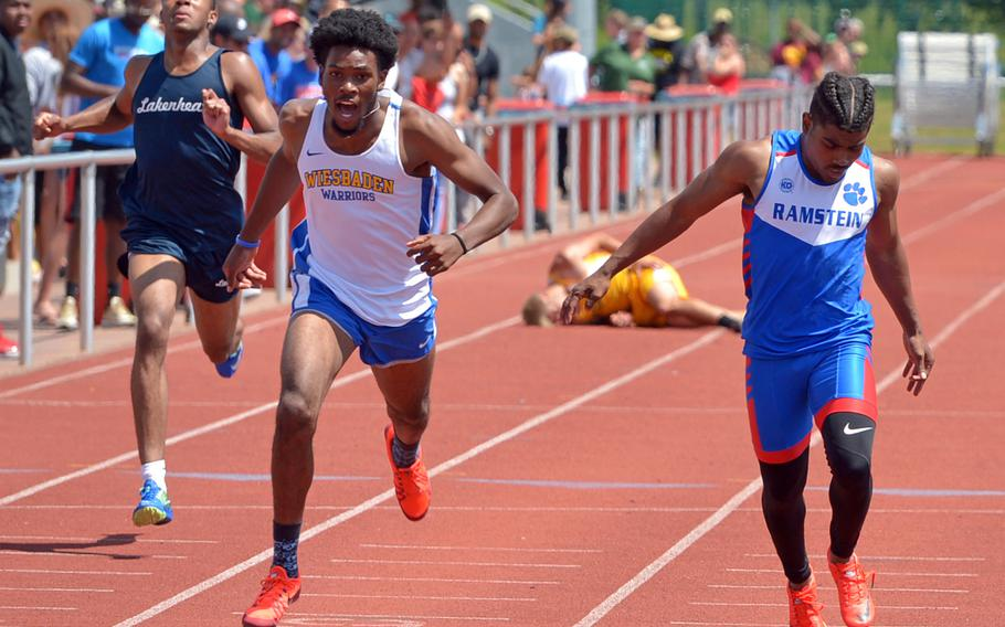 Wiesbaden's Markez Middlebrooks, center, won the boys 200-meter race at the DODEA-Europe track and field championships in 22.38 seconds. He also won the 100-meters in 11.03 seconds.