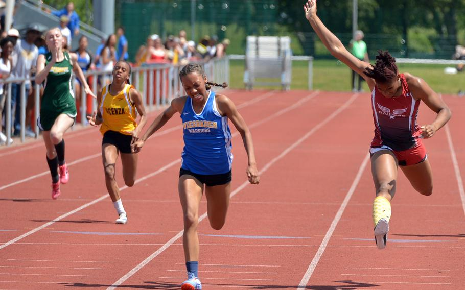 Wiesbaden's Whitney Bivins won the girls 200-meter race in 25.36 seconds ahead of Kaiserslautern's Jada Branch, right, at the DODEA-Europe track and field championships.