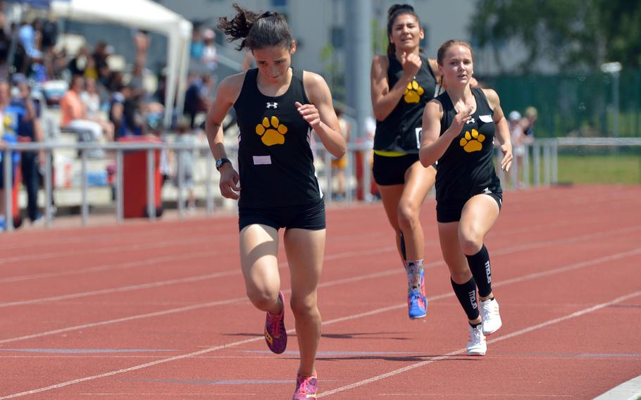 Tatiana Smith leads her Stuttgart teammates McKinley Fielding and Kate Bowman to the finish line in the girls 800-meter race at the DODEA-Europe track and field championships. Smith won in 2 minutes, 26.51 seconds.
