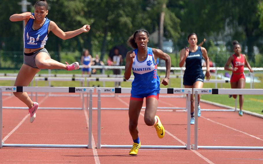 Ramstein's Christierra Williams, center, on her way to winning the girls 300-meter hurdle event at the DODEA-Europe track and field championships in 46.88 seconds.