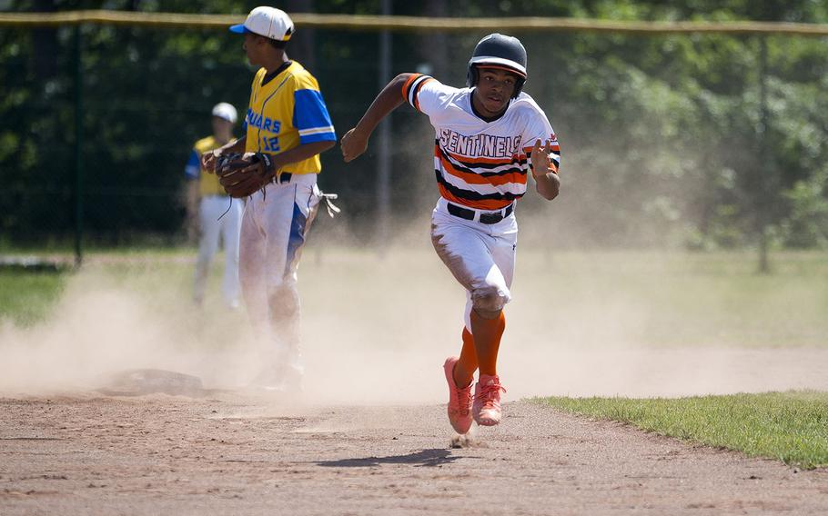 Spangdhalem's Jimmie Montgomery runs to third during the DODEA-Europe Division II/III baseball championship at Ramstein Air Base, Germany, on Saturday, May 26, 2018.