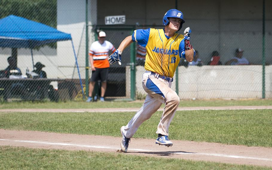 Sigonella's Cameron Camus runs to first during the DODEA-Europe Division II/III baseball championship at Ramstein Air Base, Germany, on Saturday, May 26, 2018. Sigonella defeated Spangdhalem 1-0 to win the title.