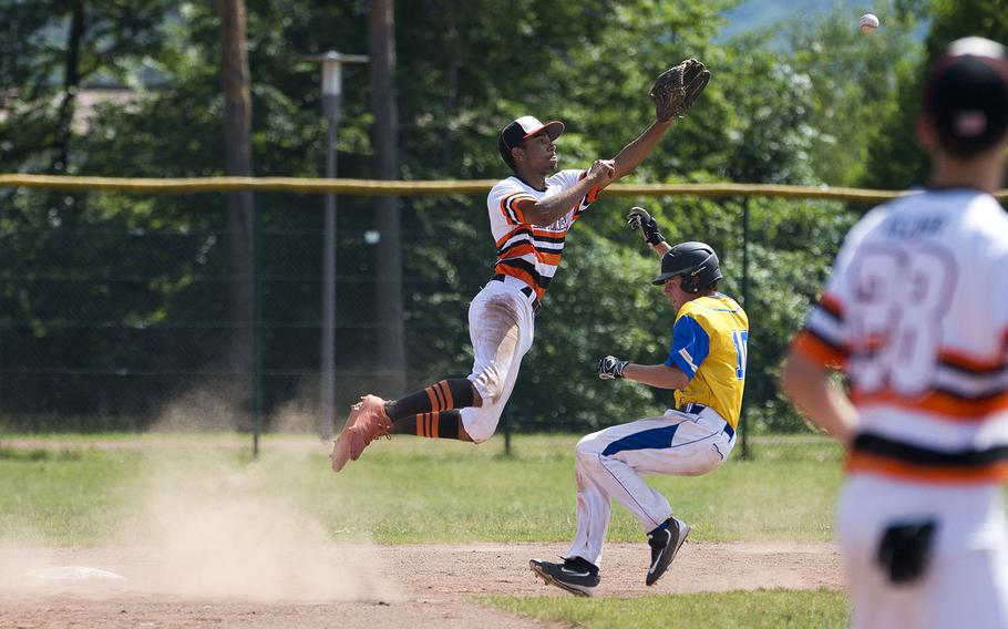 Spangdhalem's Tyriq Zvijer, left, leaps for a throw as Sigonella's Andrew Taylor runs to second during the DODEA-Europe Division II/III baseball championship at Ramstein Air Base, Germany, on Saturday, May 26, 2018.