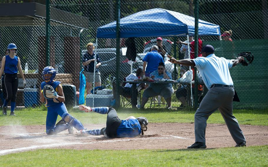 Hohenfels' Isabella Williams, right, slides in safe at home ahead of a tag by Sigonella's Averi Chandler during the DODEA-Europe Division II/III softball championship at Ramstein Air Base, Germany, on Saturday, May 26, 2018.