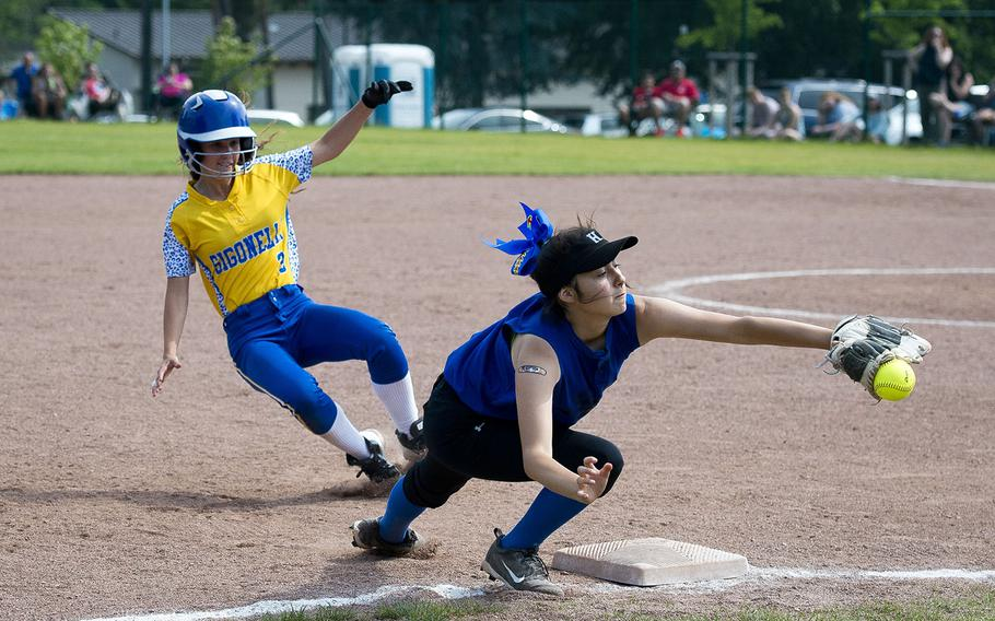Sigonella's Martina Raco, left, dives for third as Hohenfels' Alexus Garcia reaches for a throw during the DODEA-Europe Division II/III softball championship at Ramstein Air Base, Germany, on Saturday, May 26, 2018.