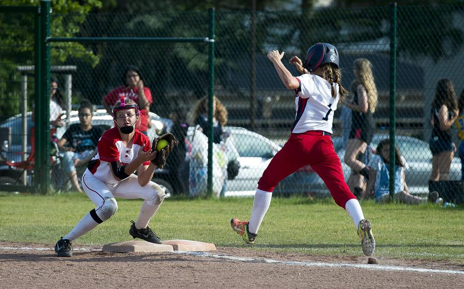 Kaiserslautern's Olivia Warren, left, catches Lakenheath's Catherine Oordt out at first during the DODEA-Europe Division I softball championship at Ramstein Air Base, Germany, on Saturday, May 26, 2018.